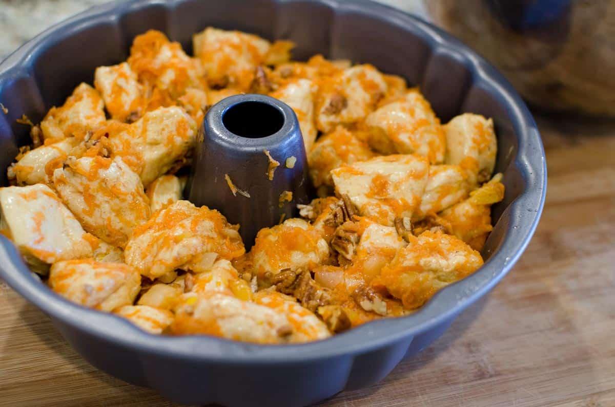 unbaked monkey bread in bundt pan