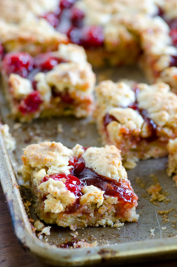 Apple Butter Cherry Cobbler Bars - These cherry cobbler bars have added depth of flavor with a secret ingredient.  Simple and sweet with cherry pie filling and the great, unique taste of Musselman's Apple Butter.