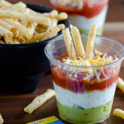 Layered Fiesta Dip with Greek Yogurt Ranch - use store-bought guacamole, salsa and Hidden Valley dry ranch mix for this very easy and convenient layered dip that's pretty, too!.