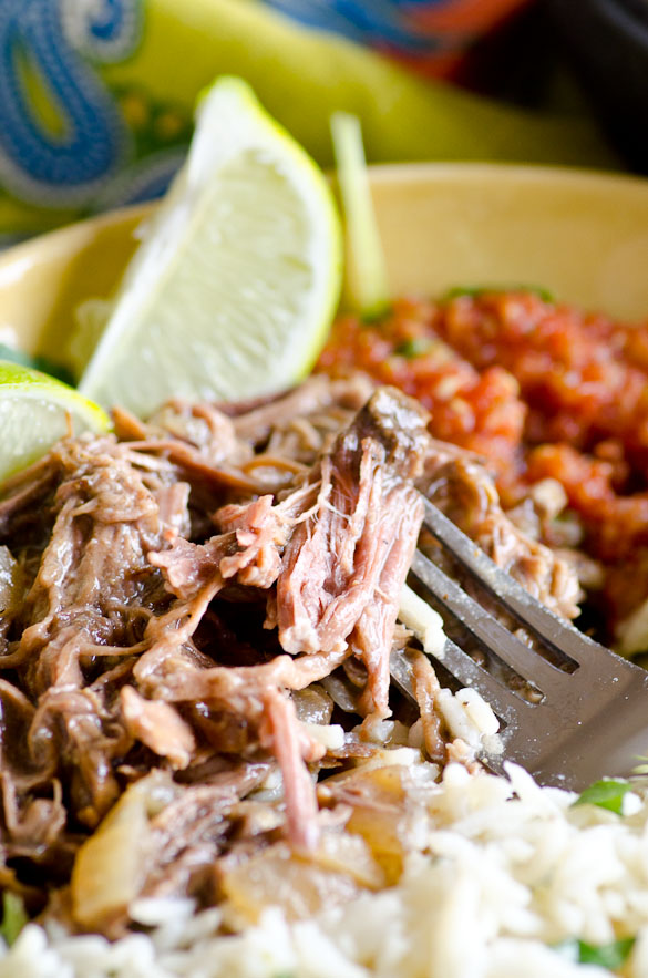Slow Cooker Beef Barbacoa - Just like Chipotle!  Slowly cooked, tender and flavorful shredded beef for tacos or burrito bowls.