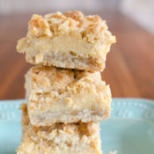 Oatmeal Lemon Cream Bars - These easy lemon bars have a creamy lemon filling between two thick crumbly oatmeal layers. A delightful balance of sweet and tangy!