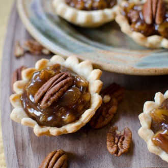 mini pecan pies on a platter