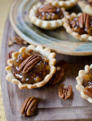 mini pecan pies on a platter
