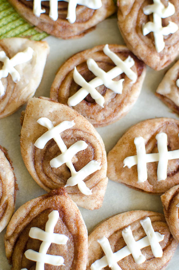 Cinnamon cookies in the shape of a football with icing threads.