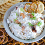 "This super easy cheesy bacon ranch ""Crack"" Dip combines simple ingredients for an irresistible dip! This 5-minute Crack Dip recipe is great with crackers, pretzels, veggies, chips, etc. Everyone needs this dip recipe in their collection, if it's not already there."