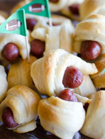 stacked pigs in a blanket with football flag toothpicks