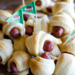 "Cocktail sausages and refrigerated crescent rolls are the only two ingredients needed for this mini Pigs in a Blanket recipe. During football season we call these ""Pigskins in a Blanket"" for a fun tailgating snack!"