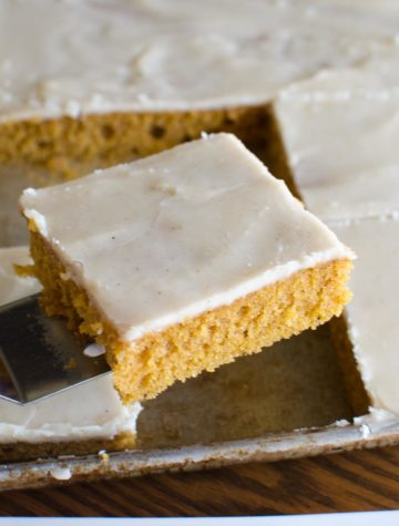 square slice of pumpkin sheet cake in pan
