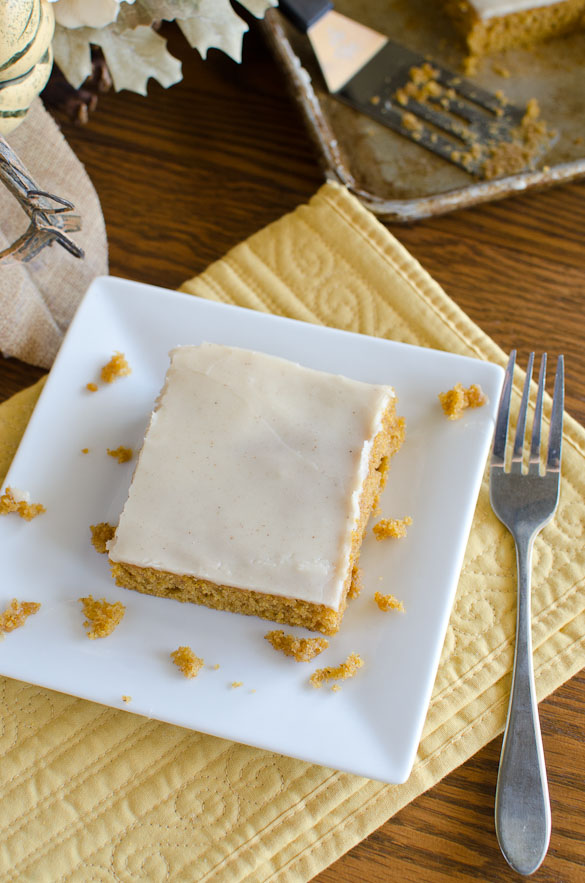A rich and tender pumpkin cake with a thin layer of brown butter icing poured over the warm cake right from the oven! This pumpkin spice sheet cake is a fall favorite and feeds many people!
