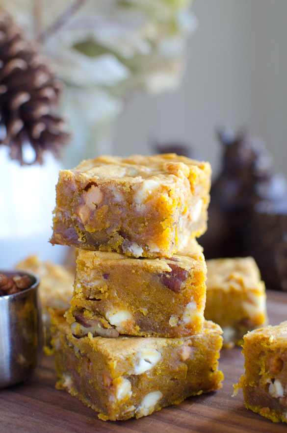 A recipe for Pumpkin Blondies loaded with rich flavors of fall and a thick gooey texture. These rich sweet dessert bars are packed with white chocolate chips, butterscotch chips and pecans.