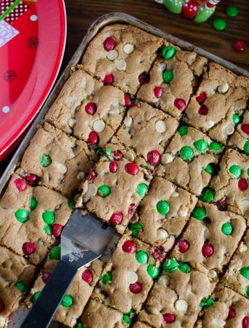 The best and easiest Christmas M&M Cookie Bars that are perfect for your Christmas cookie exchange! These gooey and chocolaty Christmas M&M Cookie Bars are loaded with red and green M&M's, chocolate chips and white chocolate chips for a festive holiday cookie treat!