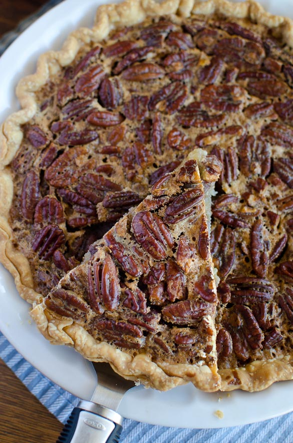 The BEST and most simple Pecan Pie recipe for the holidays. This classic southern pie is easy with just a few ingredients and few minutes. Our favorite pecan pie filling is loaded with pecans and uses a pre-made pie crust.