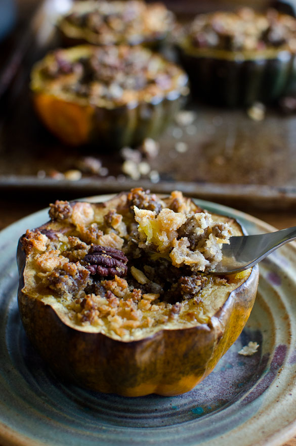 This easy weeknight dinner (or breakfast!) involves cooking stuffed acorn squash in the oven with a flavorful sausage and pecan filling. This Sausage-Stuffed Acorn Squash recipe will soon turn into your family's favorite.
