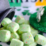 These Leprechaun Bites are tiny little shortbread cookies ready with just 15 minutes of prep. Use green, orange and yellow sprinkles and green food coloring to create the perfect little handful of munchies! These are perfect to bag up in treat bags or miniature cauldrons for festive Saint Patrick's Day gifts!