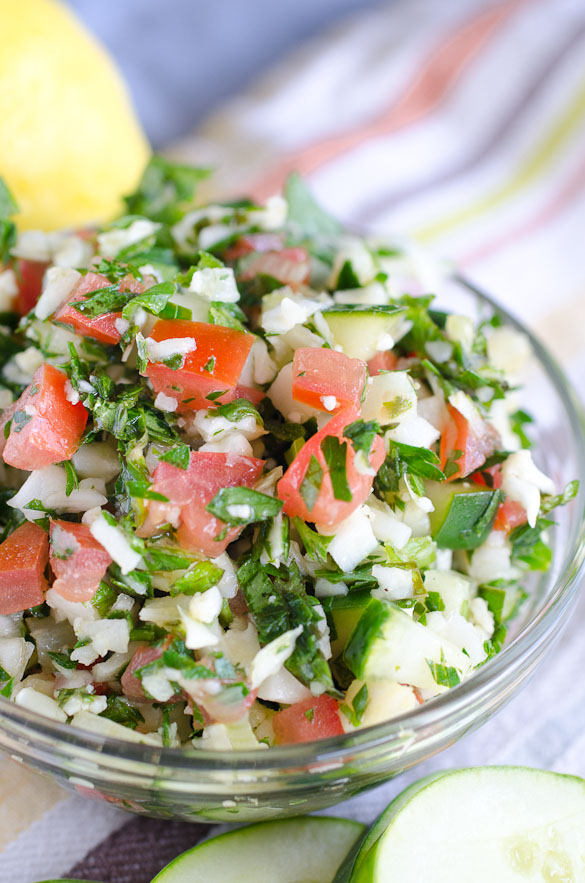 This Cauliflower Tabbouleh salad is a twist on the traditional Lebanese Tabbouleh with cauliflower replacing the wheat.  There are less herbs and more fillings like tomatoes and cucumbers in this Cauliflower Tabbouleh Salad recipe, but the spices of our favorite Middle Eastern dish remain!
