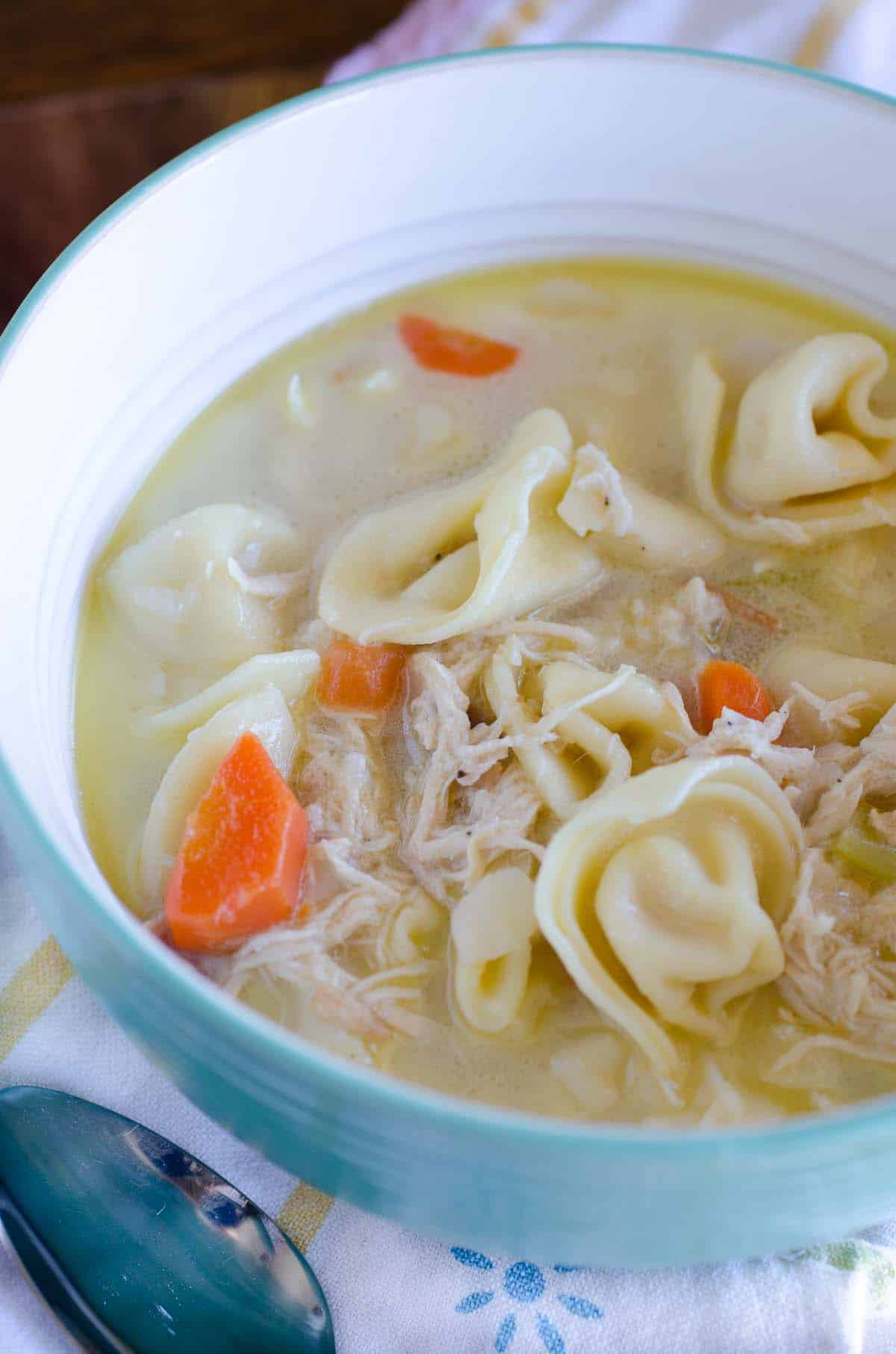 bowl of chicken and cheese tortellini soup
