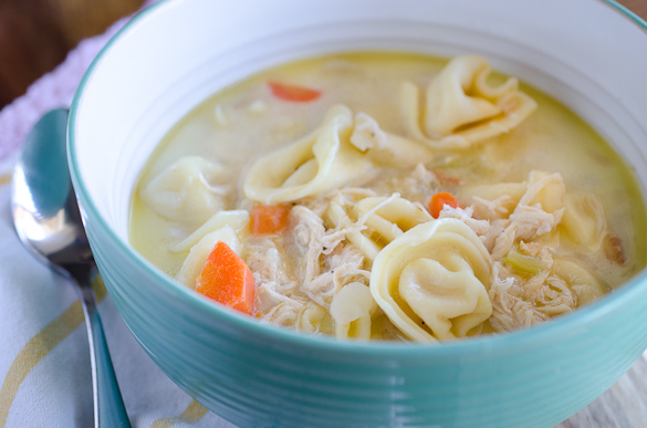 This weeknight Chicken and Cheese Tortellini Soup is an easy and flavorful dinner to quickly get on the table.  It's a simple dinner idea for a family favorite meal!
