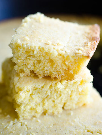Two stacked pieces of fluffy cornbread.