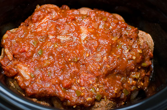 Chicken breasts in a slow cooker topped with salsa