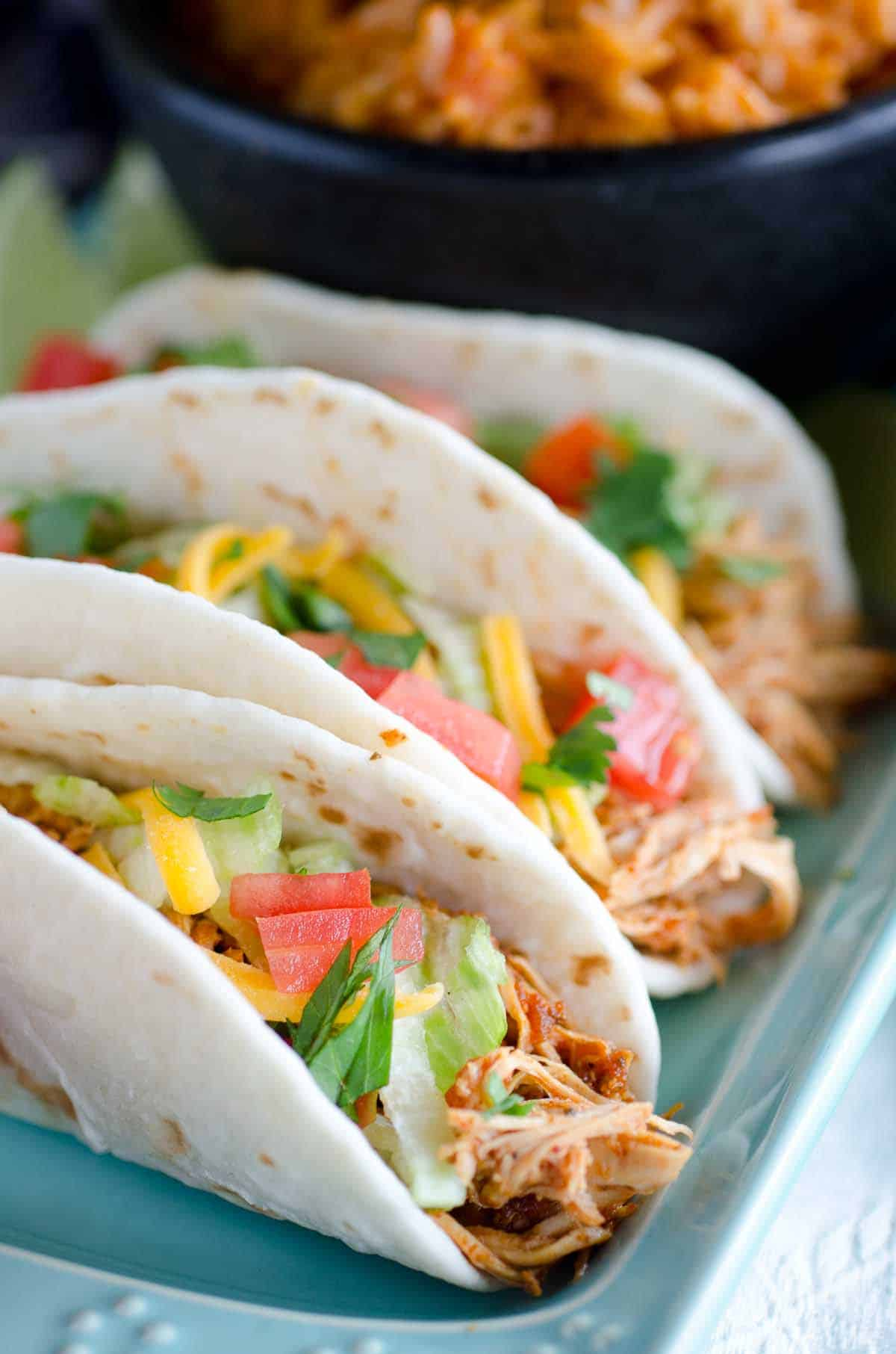 three chicken tacos on a plate