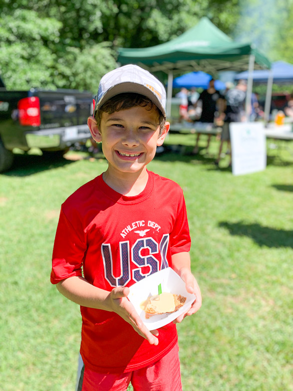 Boy holding grilled cheese sample at Belhaven's Grilled Cheese Festival