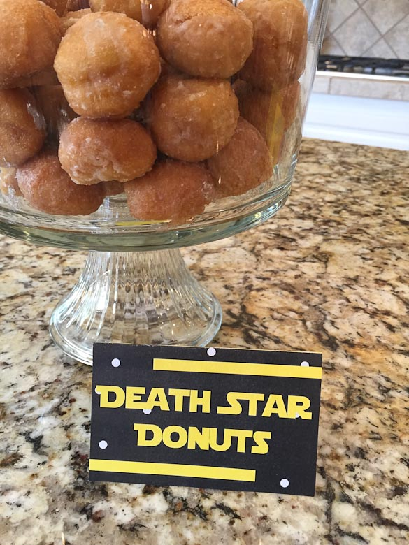 donut holes in a trifle bowl with death star donuts sign