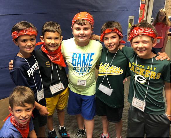3rd grade boys at VBS with orange bandanas..