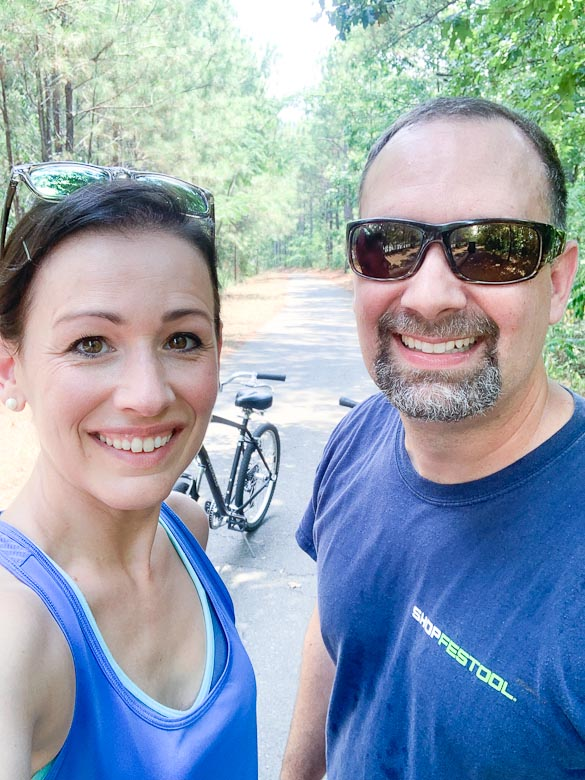 Couple bike riding on a Birmingham trail.