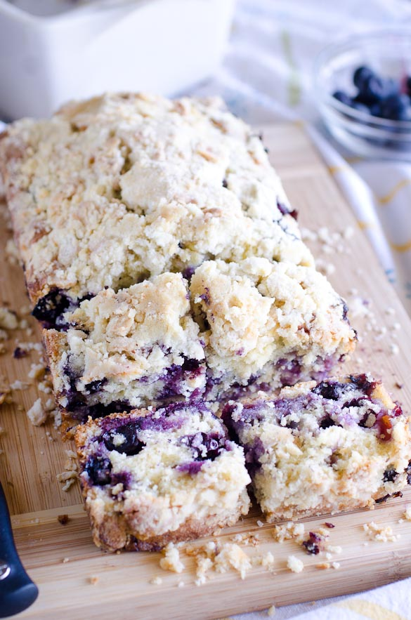 Blueberry muffin bread on cutting board.