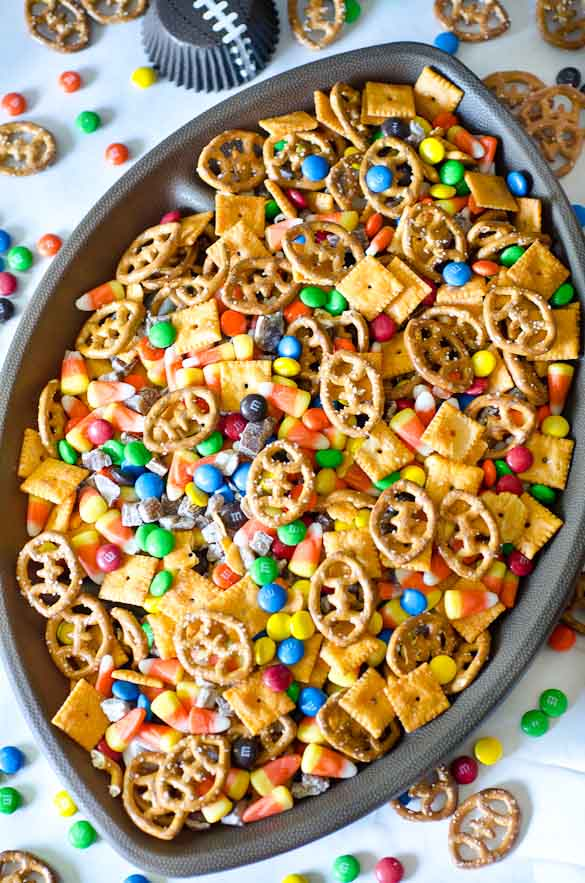 Football shaped bowl with party snack mix with football shaped pretzels
