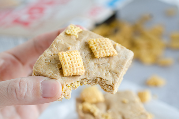 Bite of protein bar with chex cereal.