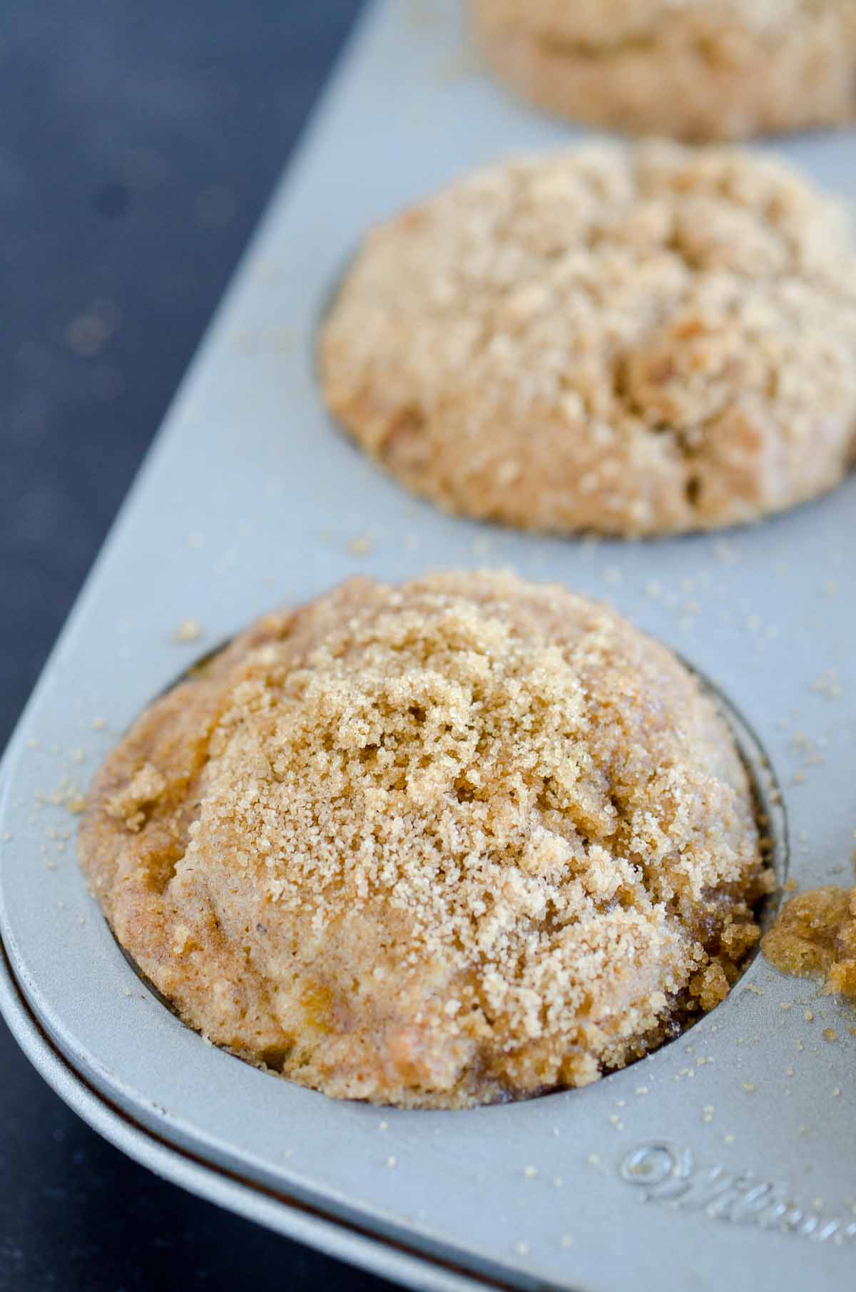 muffin with streusel topping in cucpake tin