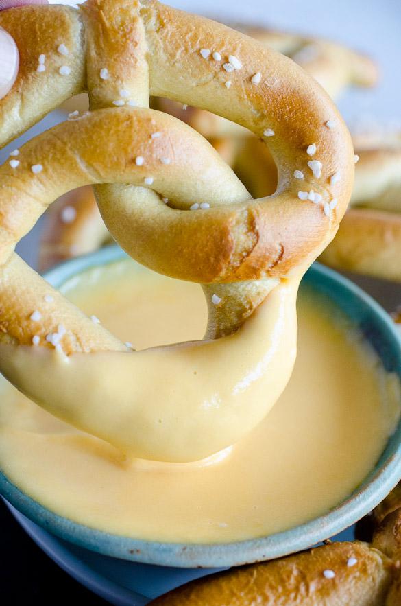 soft pretzel in cheese dip