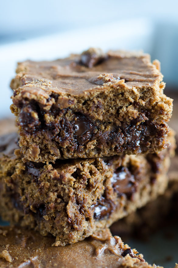 stacked chocolate pumpkin brownies with chocolate chips inside