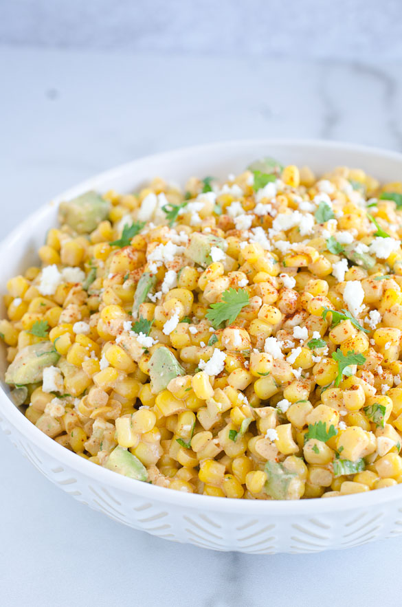 Bowl of corn salad with avocados