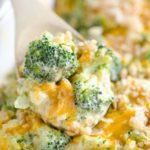 cheesy broccoli in a wooden spoon
