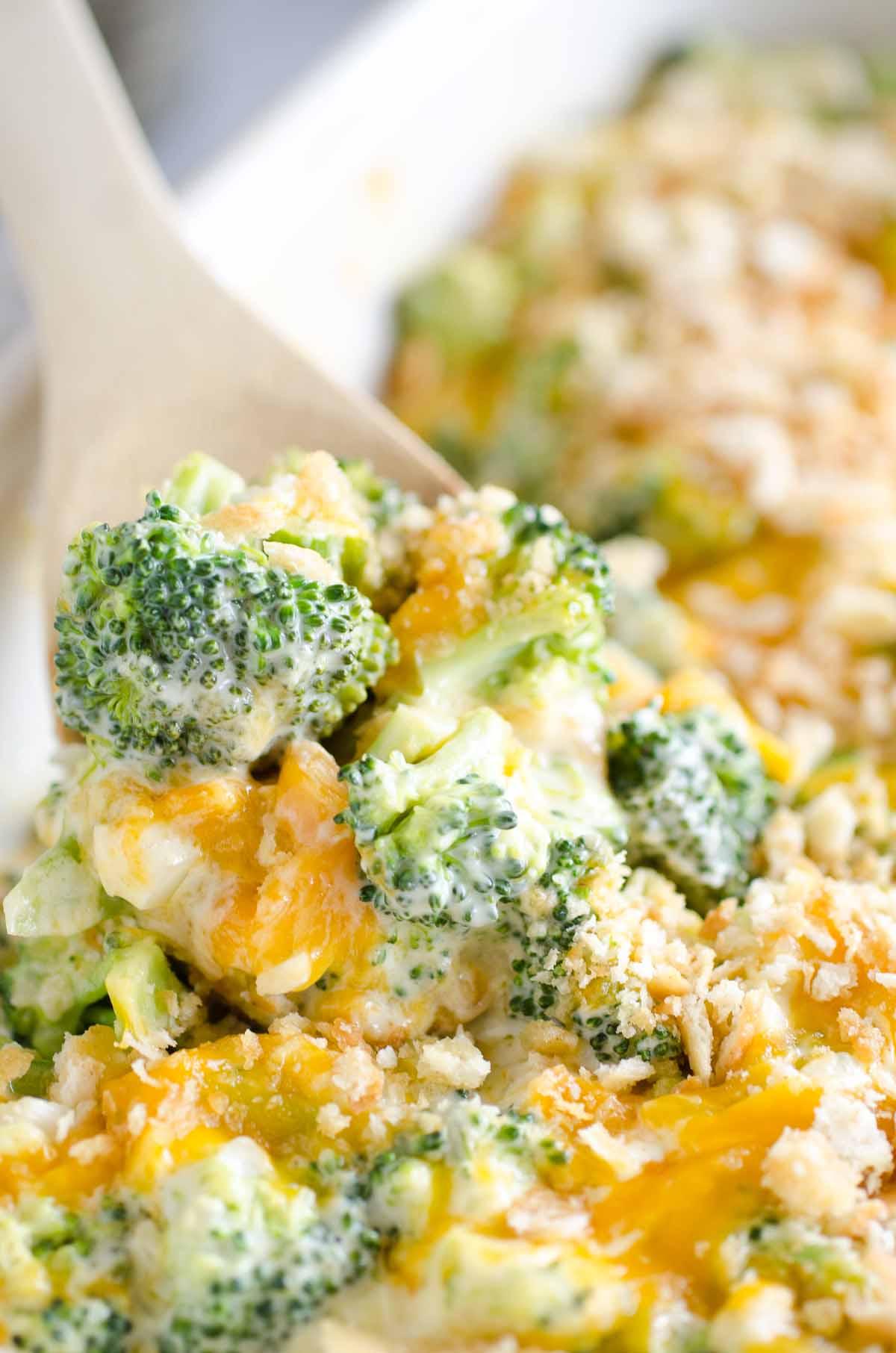 scoop of cheesy broccoli casserole