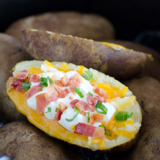 loaded baked potato with all the fixins in a crock pot