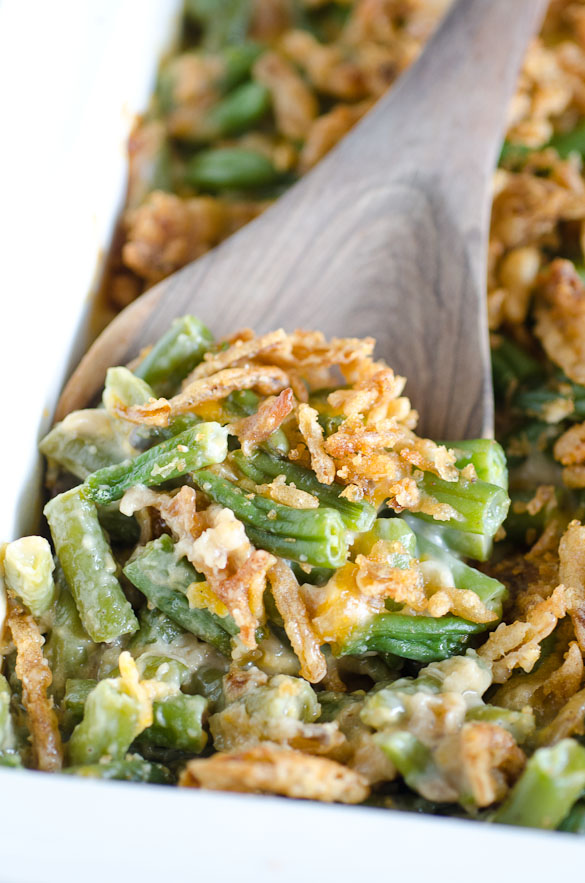 spoonful of green bean casserole with crispy onion topping