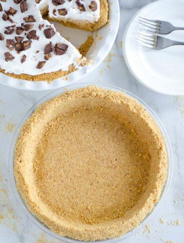 graham cracker pie crust with peanut butter pie in background