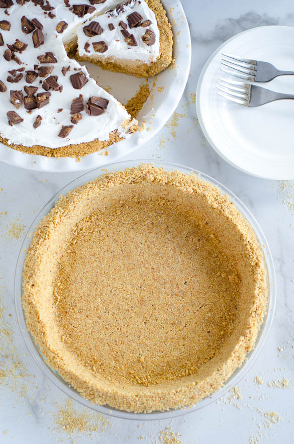 graham cracker pie crust with peanut butter pie in background