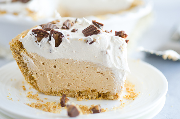 slice of peanut butter pie topped with cool whip