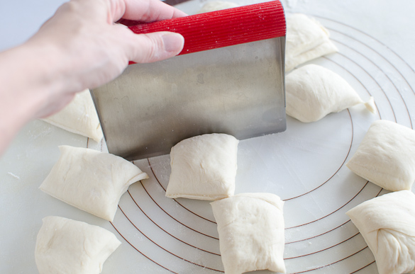 cutting dough into squares with dough cutter
