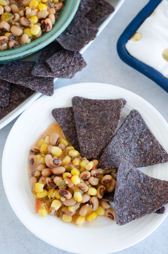 plate of chips and black eyed pea dip