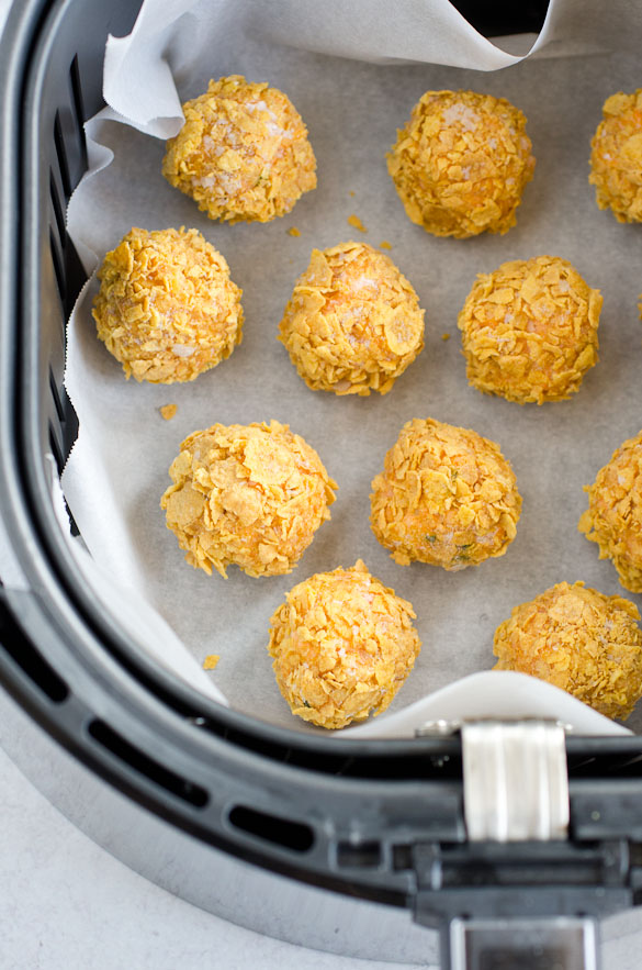 buffalo chicken cheese balls in air fryer lined with parchment paper