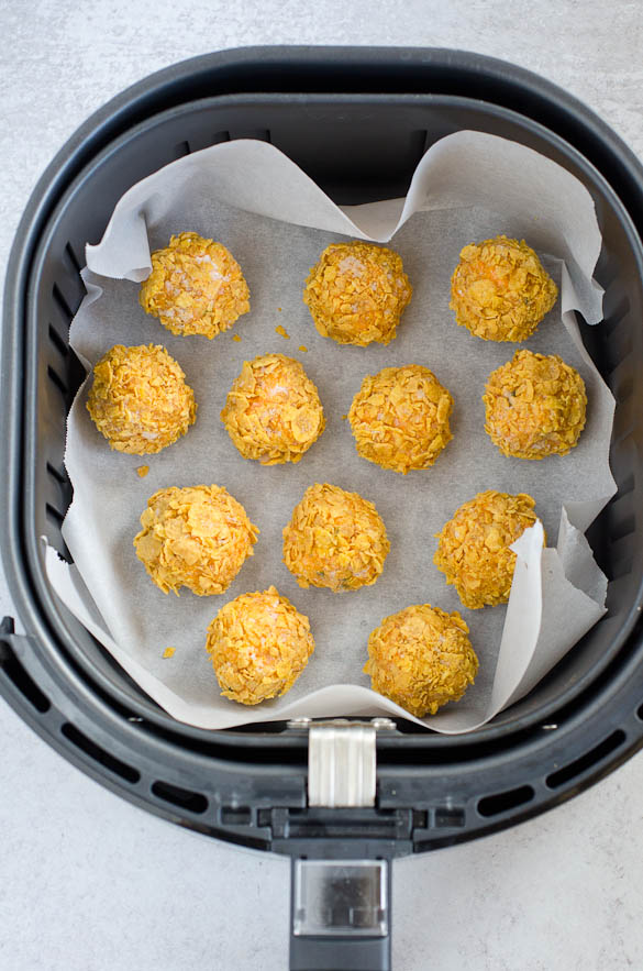chicken bites in an air fryer basket