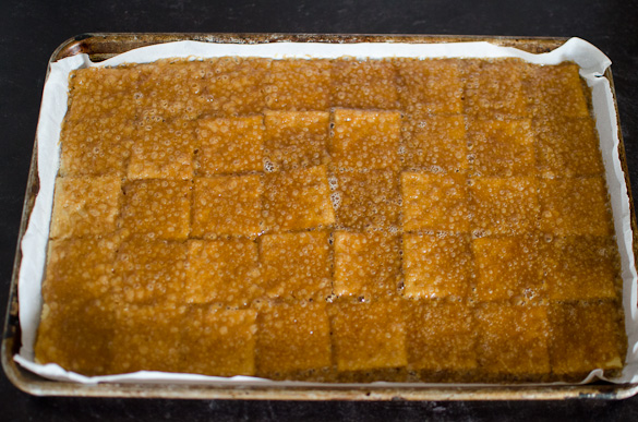 toffee over saltine crackers in baking sheet
