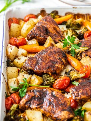 baking pan full of roasted chicken and veggies