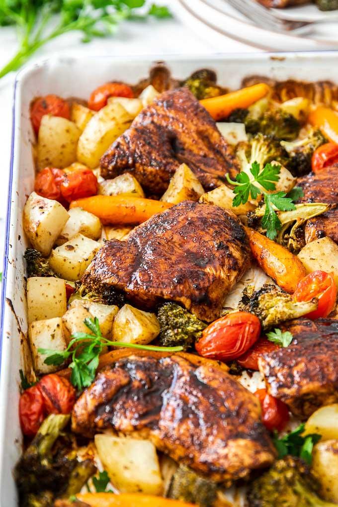 baking pan full of roasted chicken and veggies