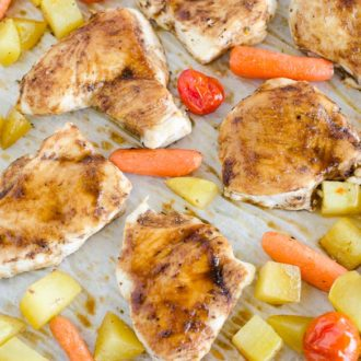 roasted chicken and veggies on a pan